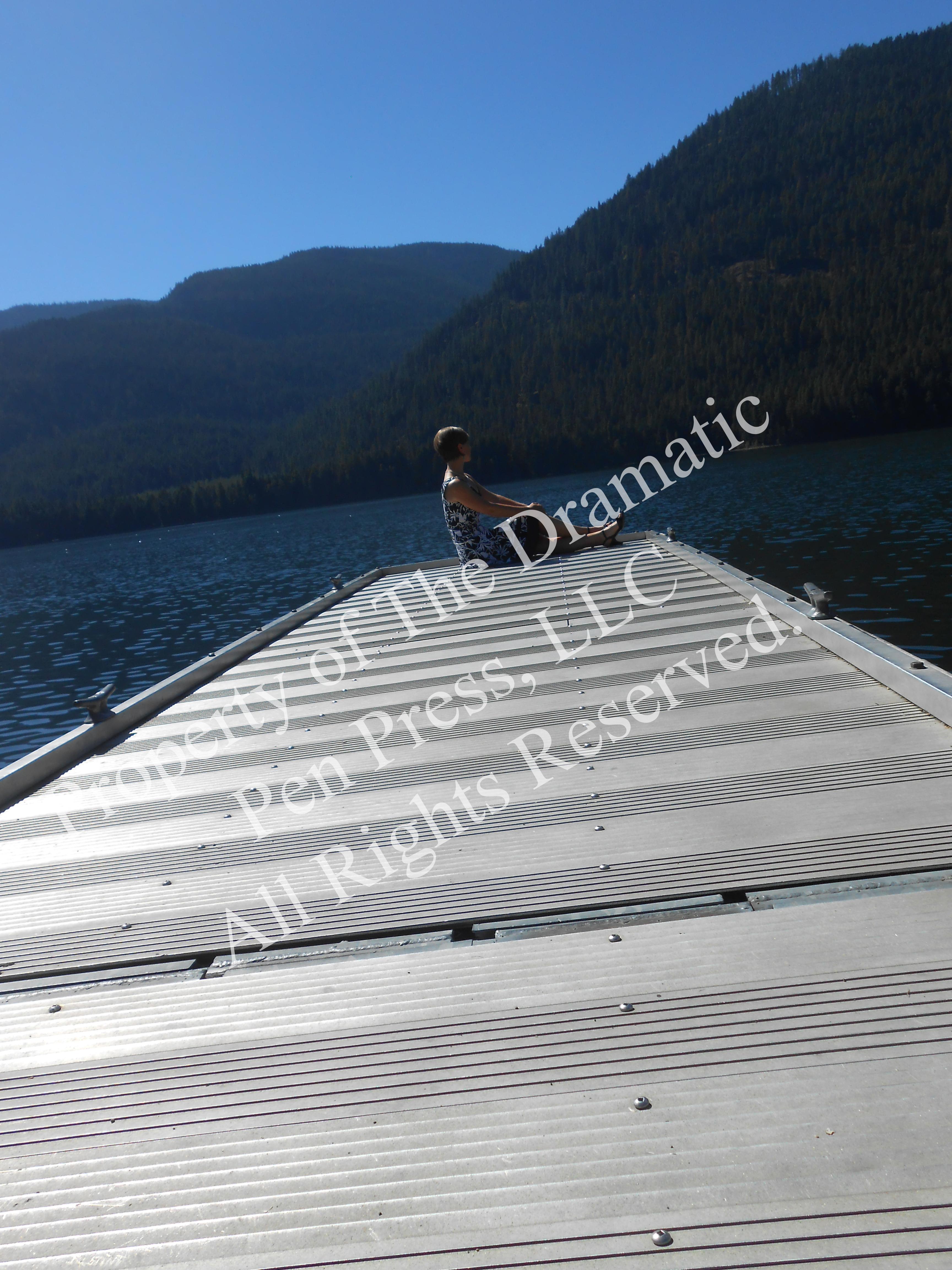 Woman End of Dock Mountain Lake