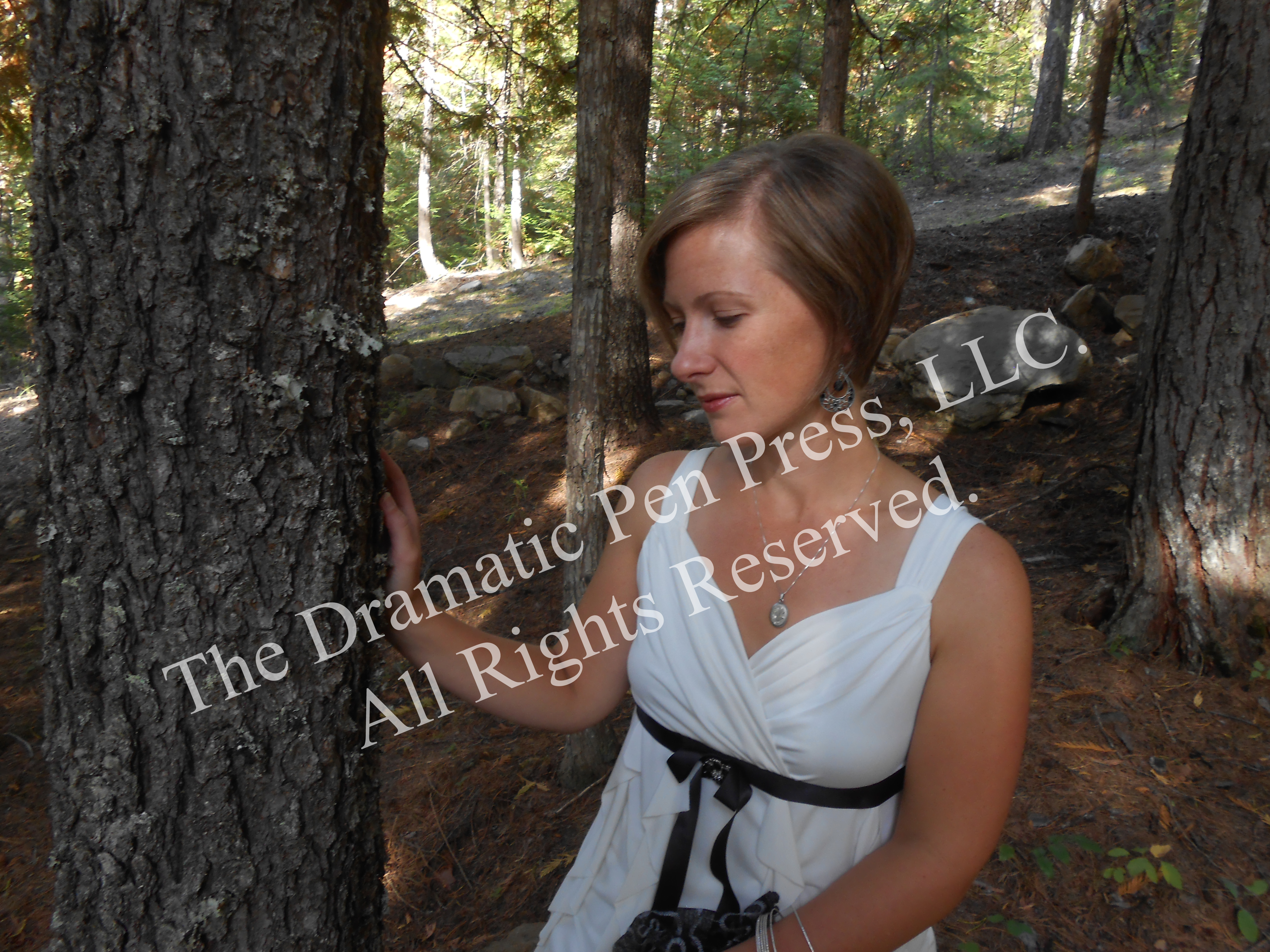 Woman Sitting in Woods White Dress