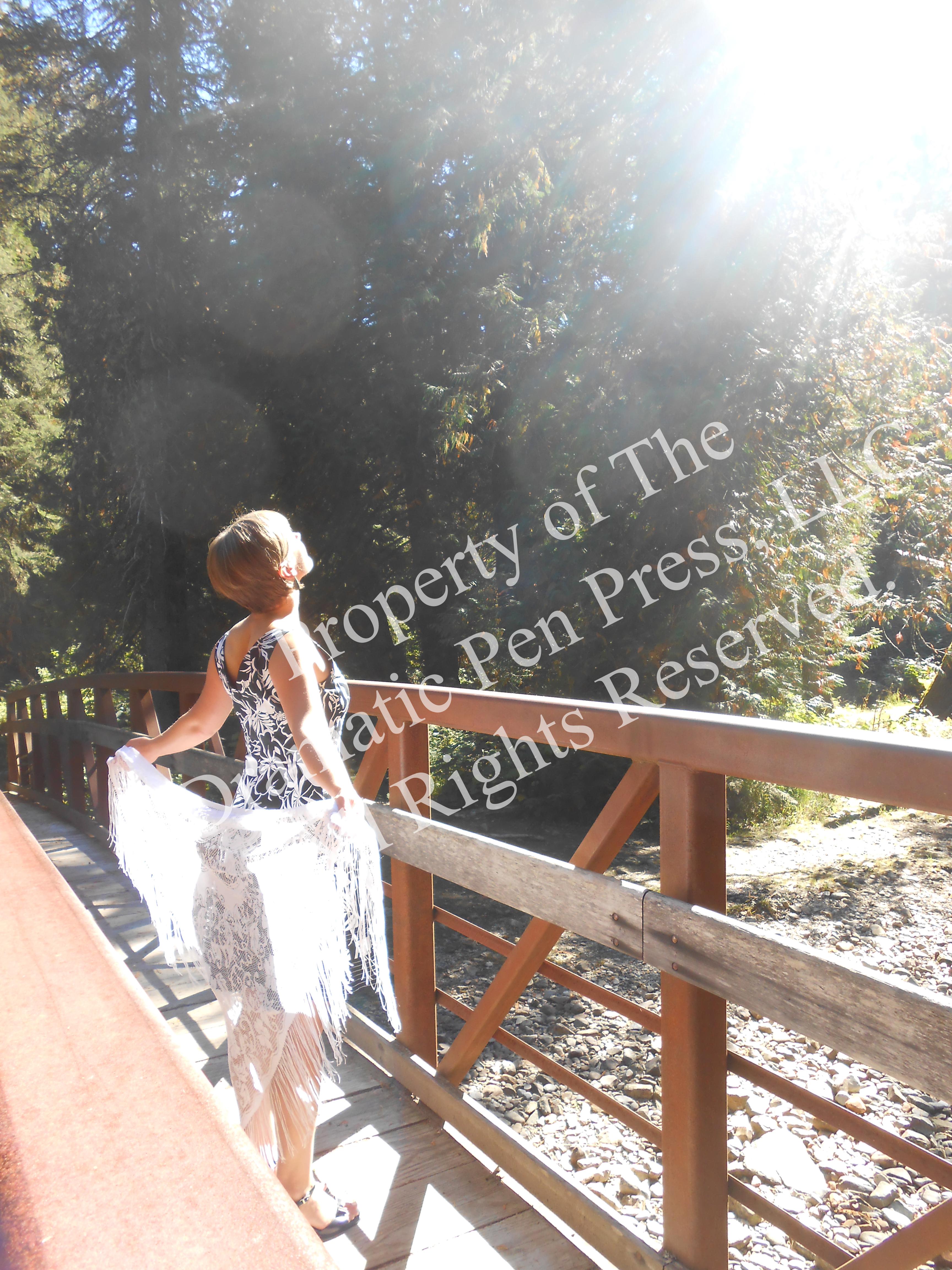 Woman in Sun on Bridge
