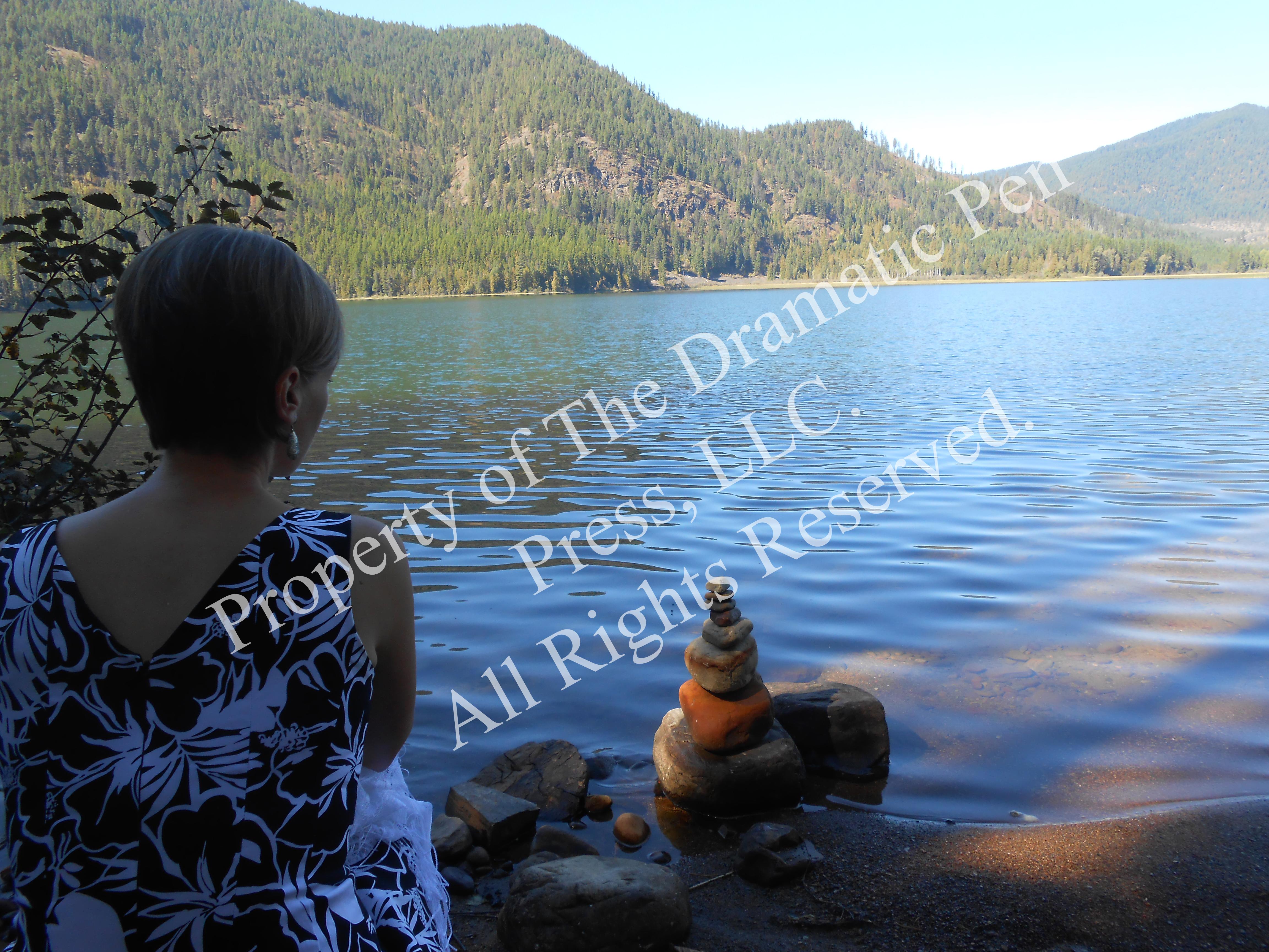 Woman Overlookign Lake Pretty Stones