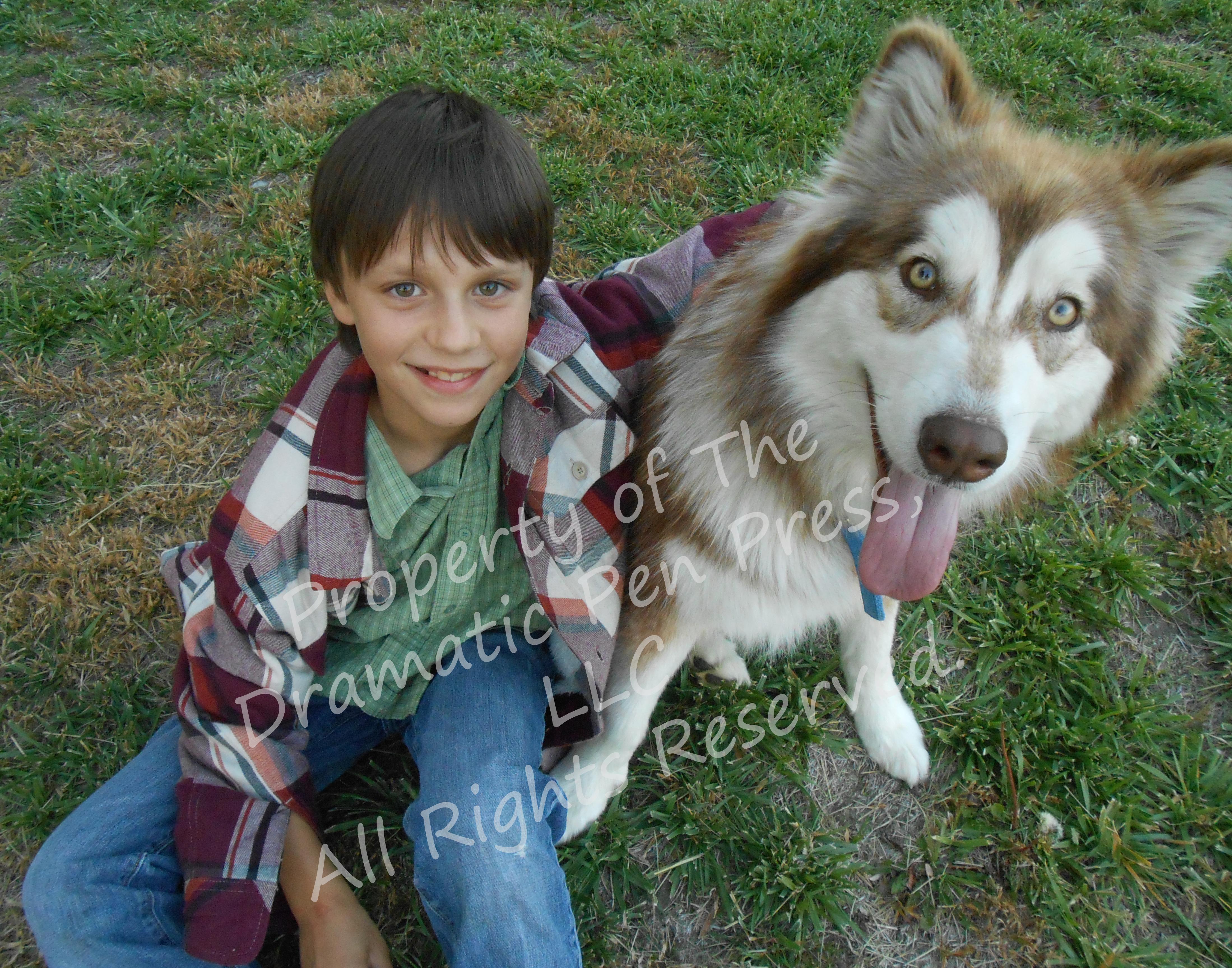 Smiling Boy Sitting with Dog