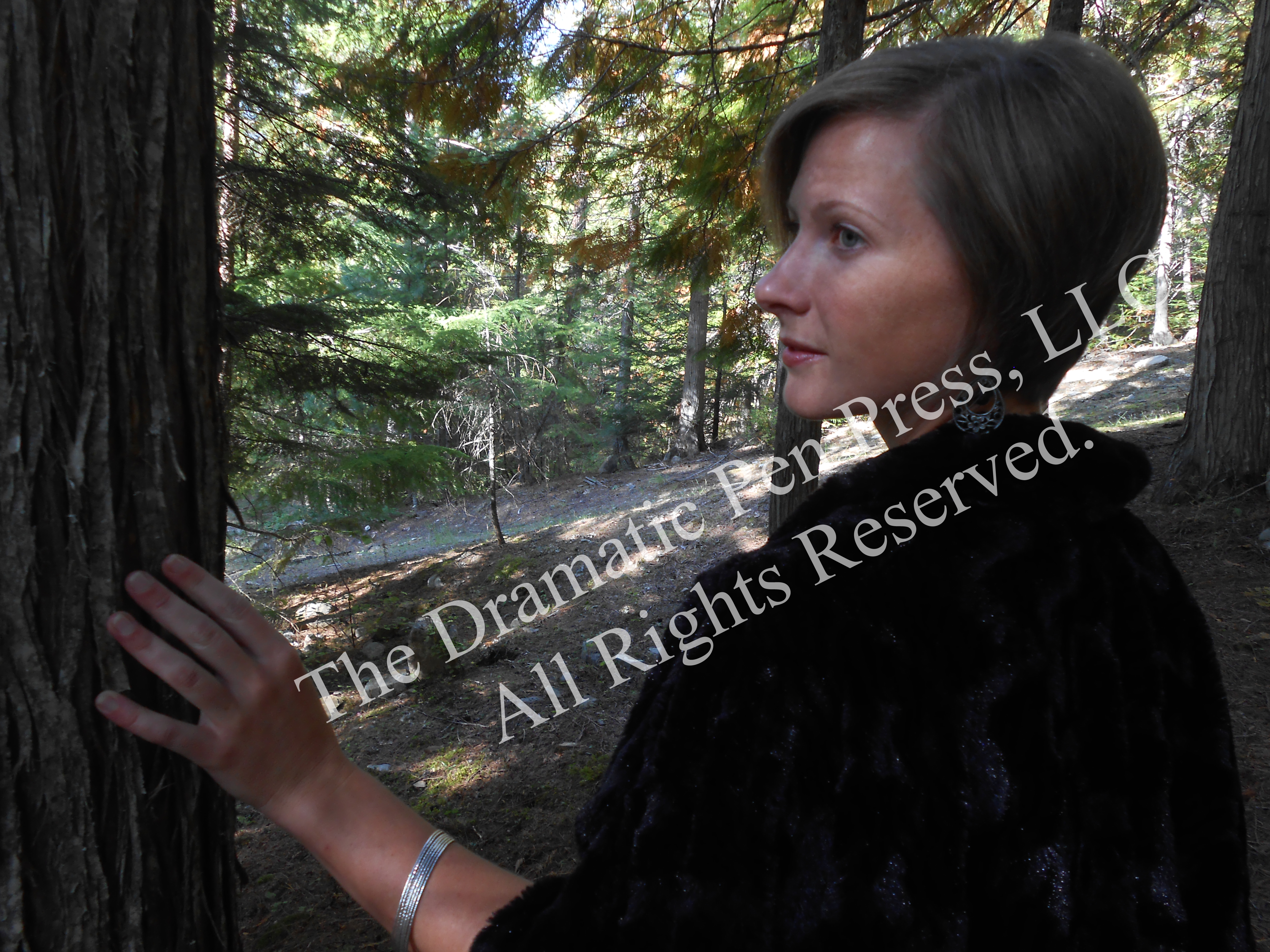 Beautiful Woman by Tree in Woods Fur