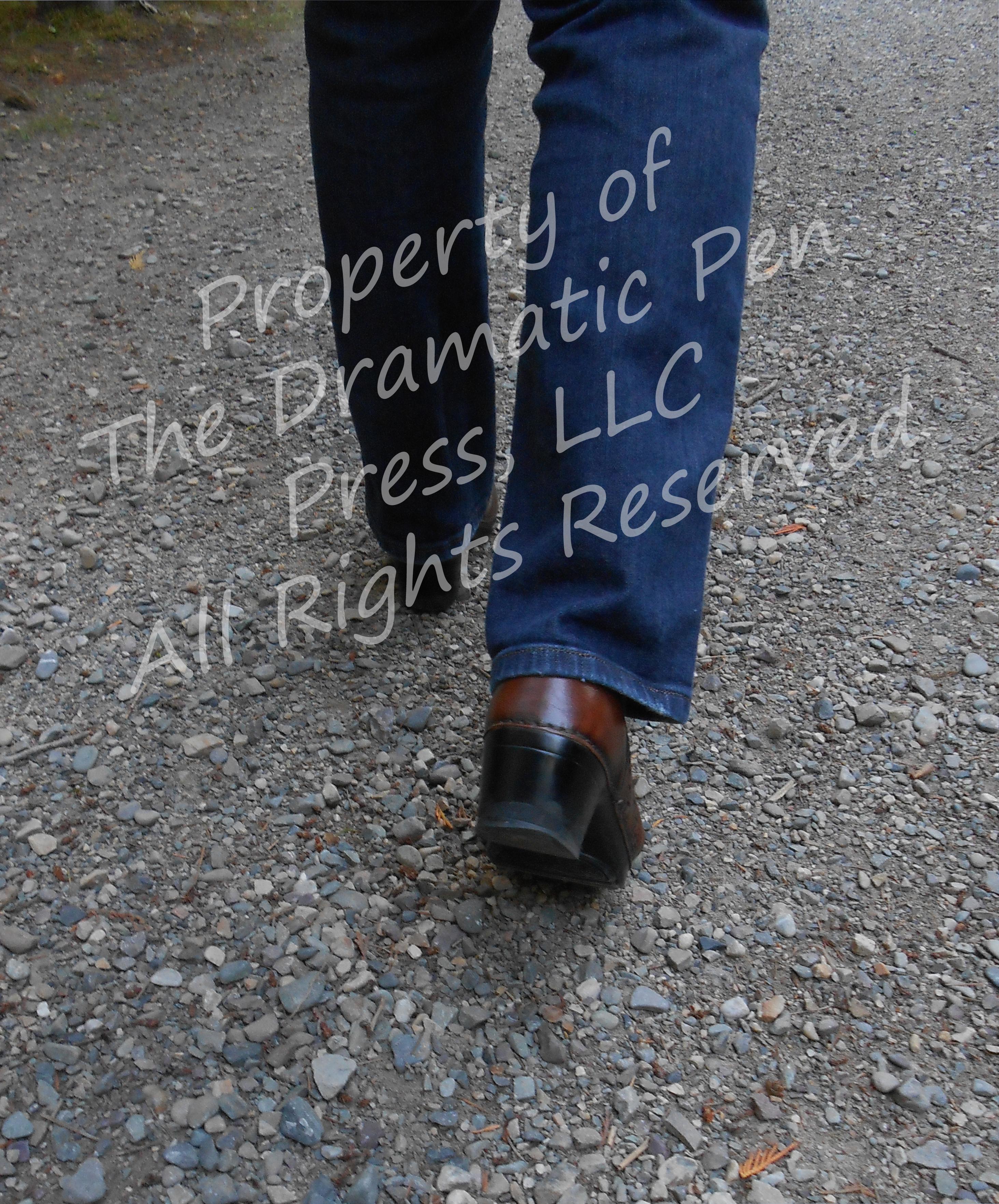 Woman's Legs Walking on Stone Path