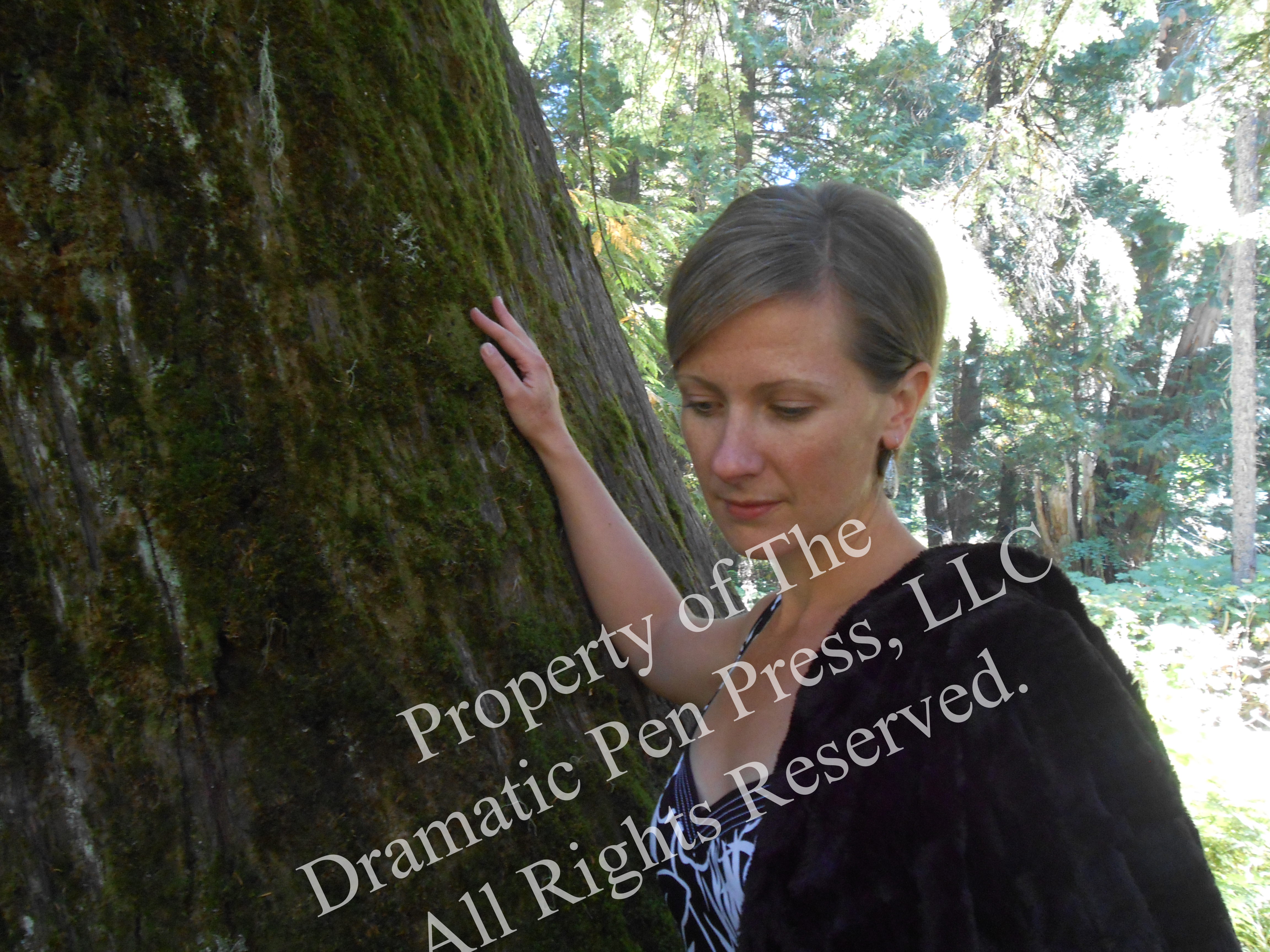 Pensive Woman in Woods