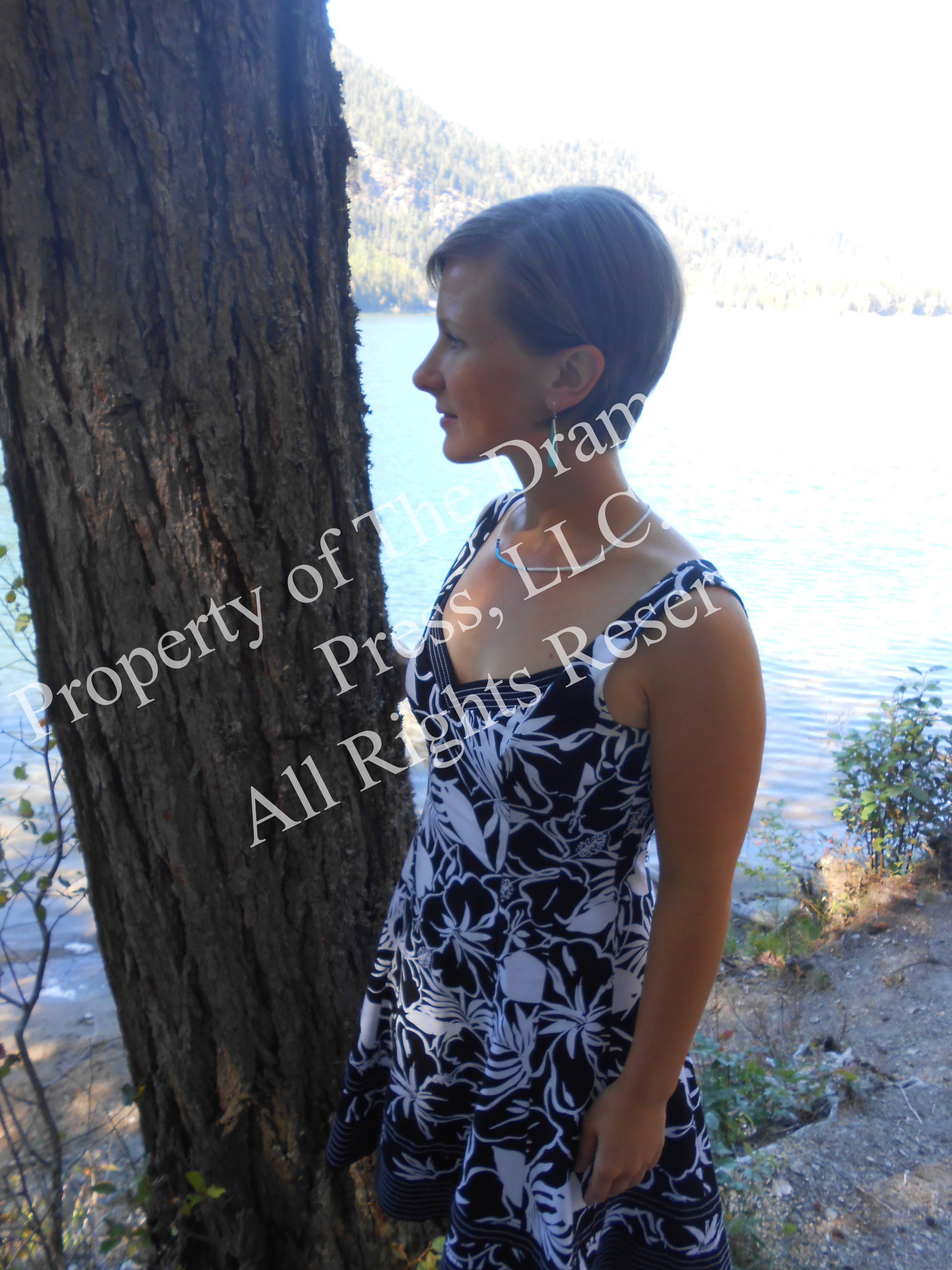 Young Woman by Tree & Lake