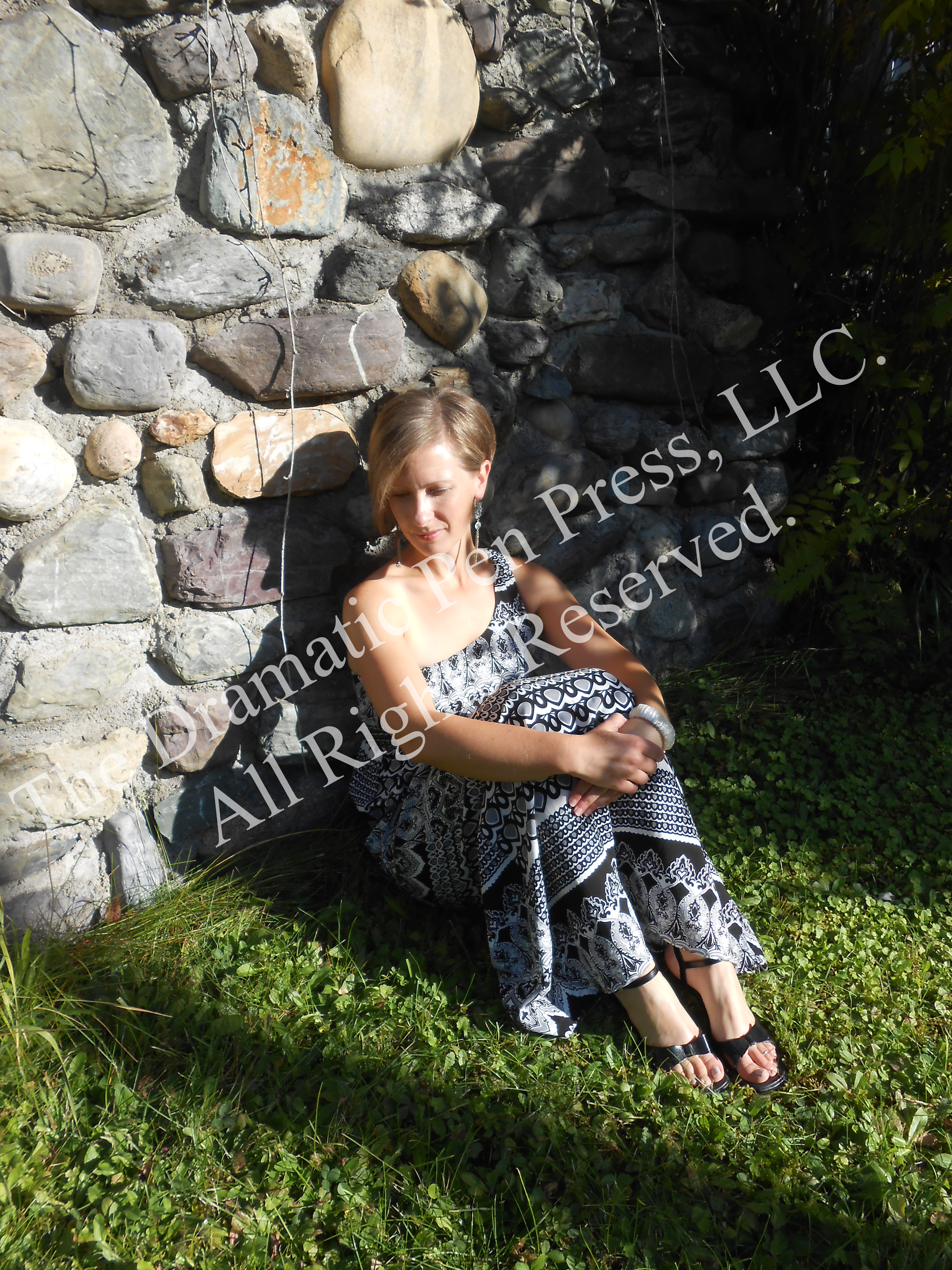 Woman Leaning Against Stone Wall