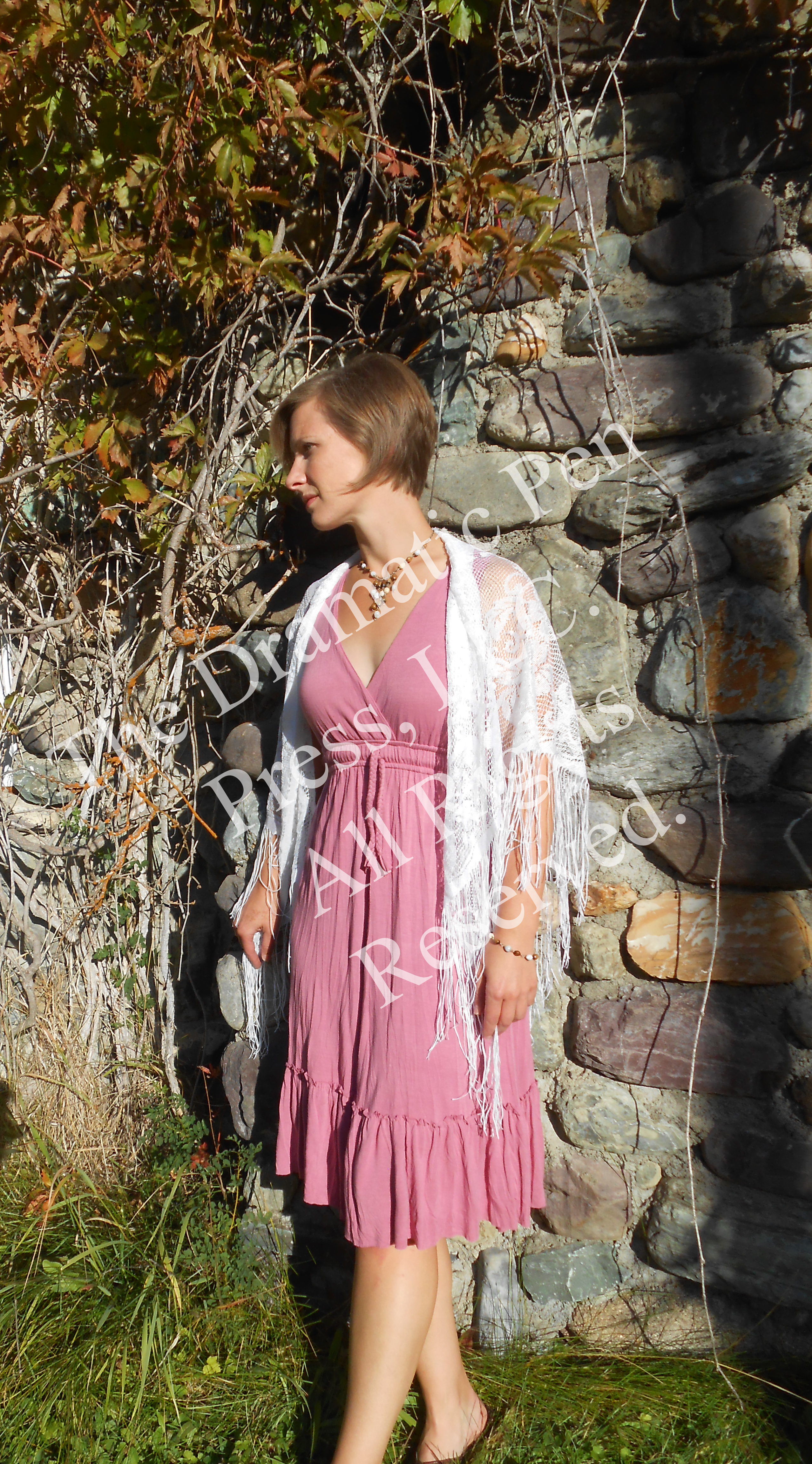Woman in Pink by Stone Wall