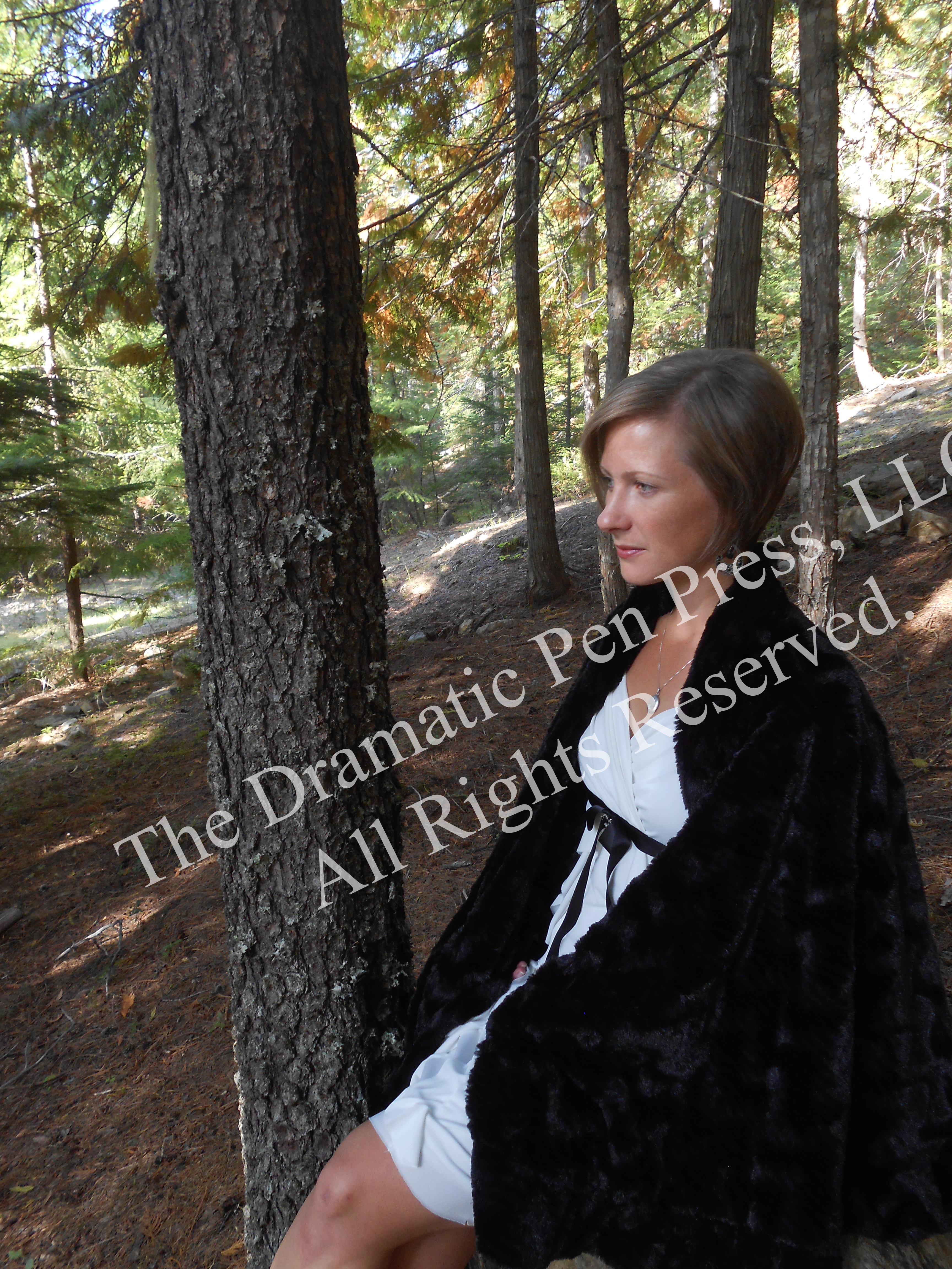 Woman Sitting in Woods Fur Coat