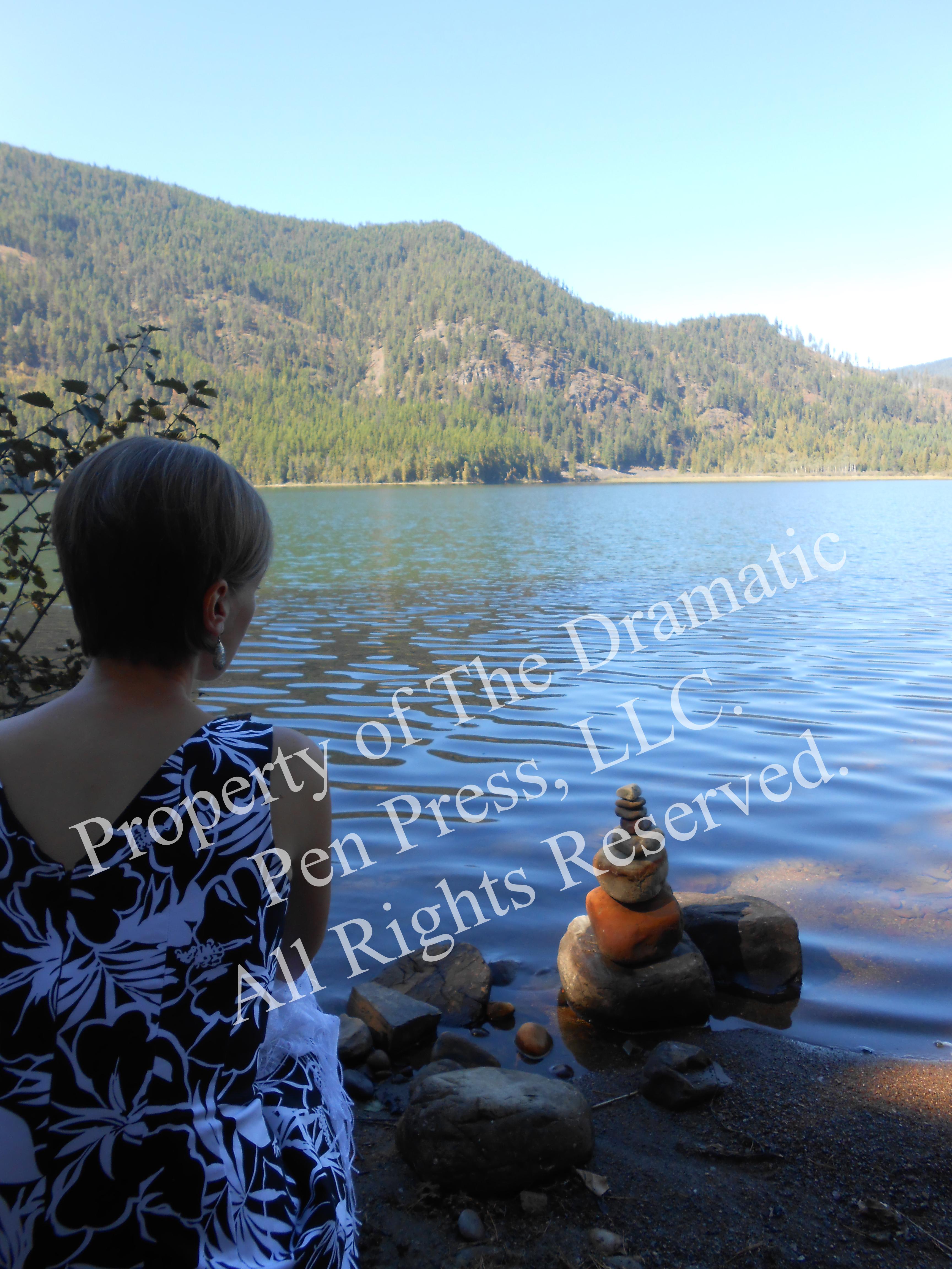 Woman Overlooking Lake & Stones