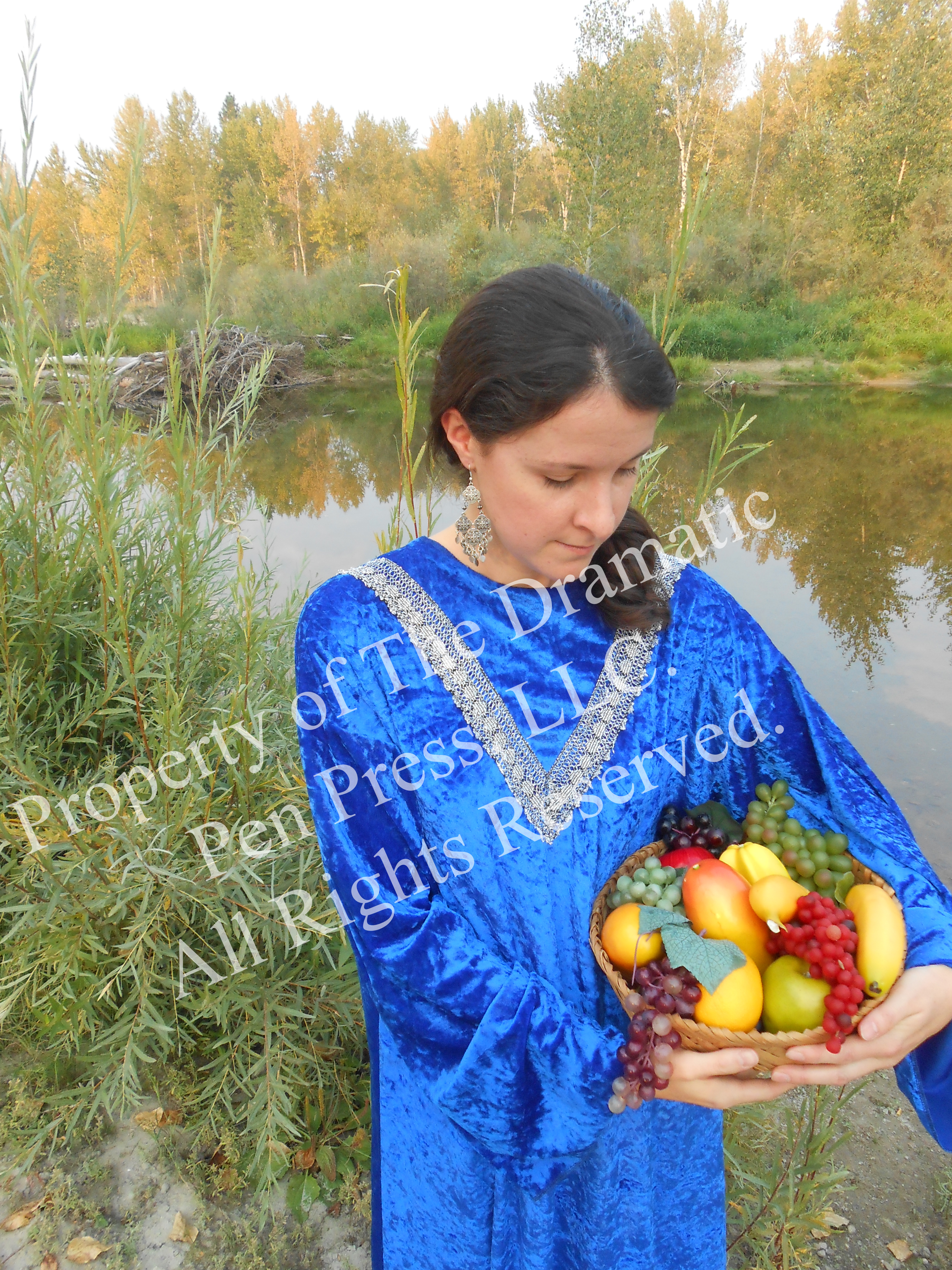 Woman by River Basket of Fruit