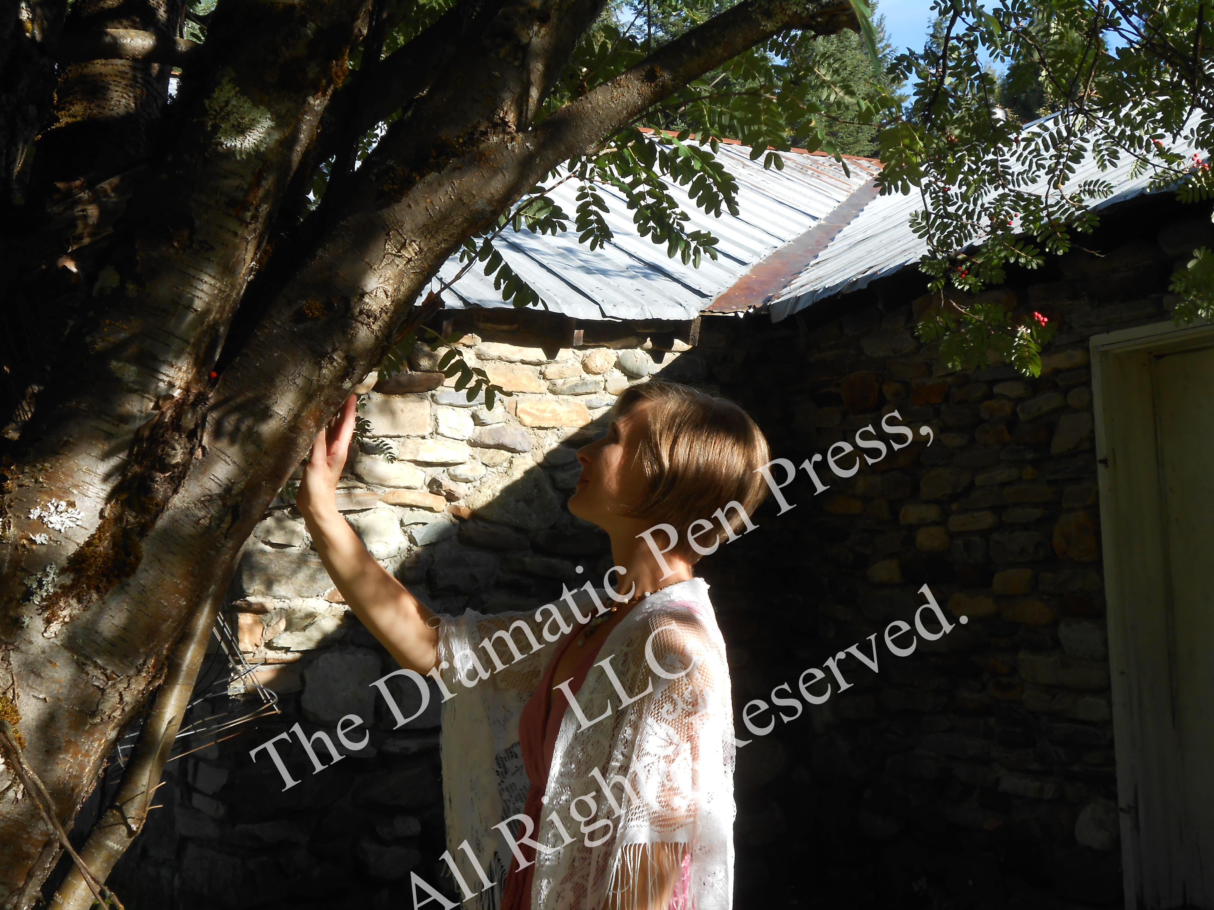 Woman Touching Tree Stone HOuse