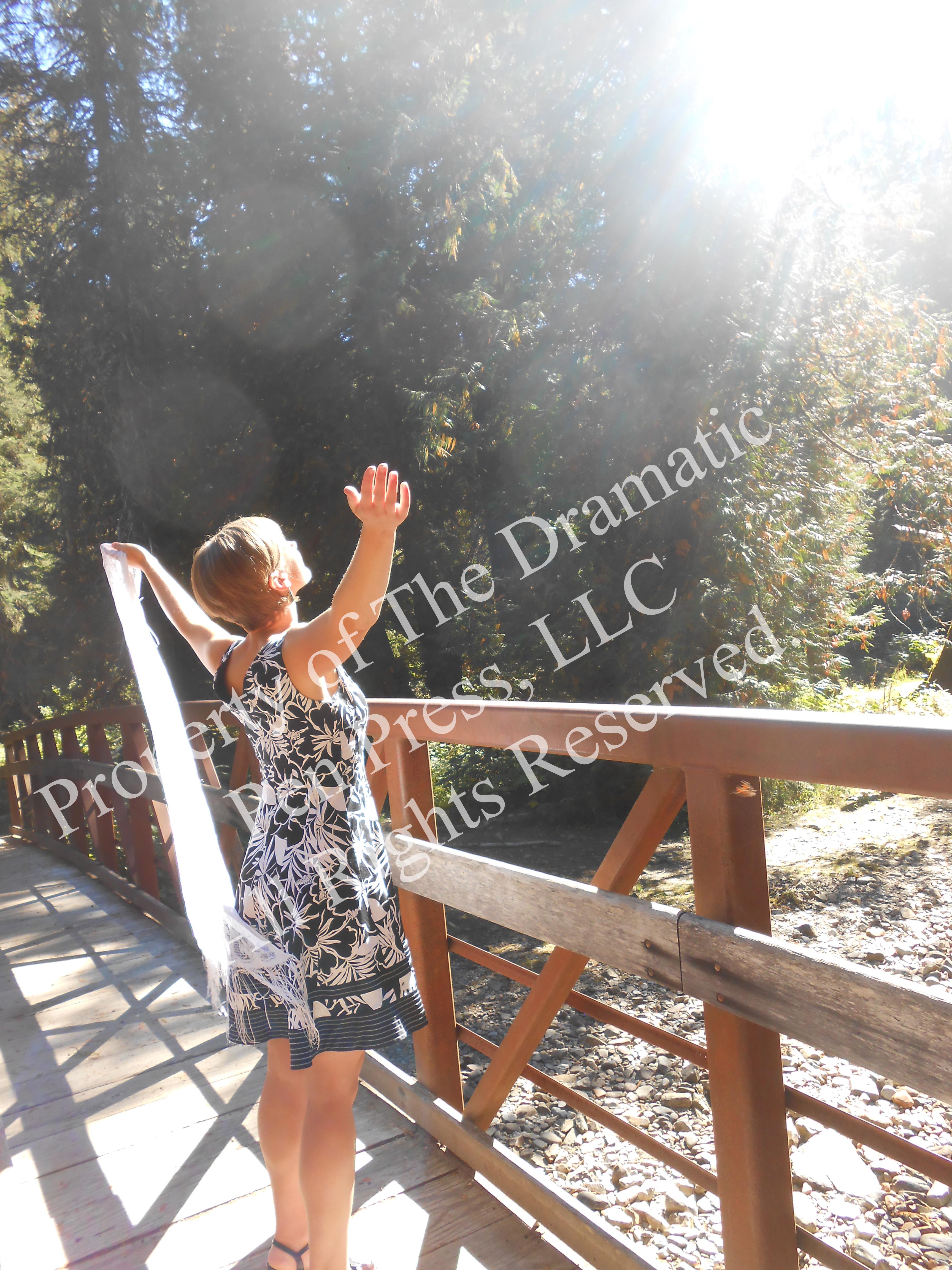 Woman on Bridge Arms Raised Sun