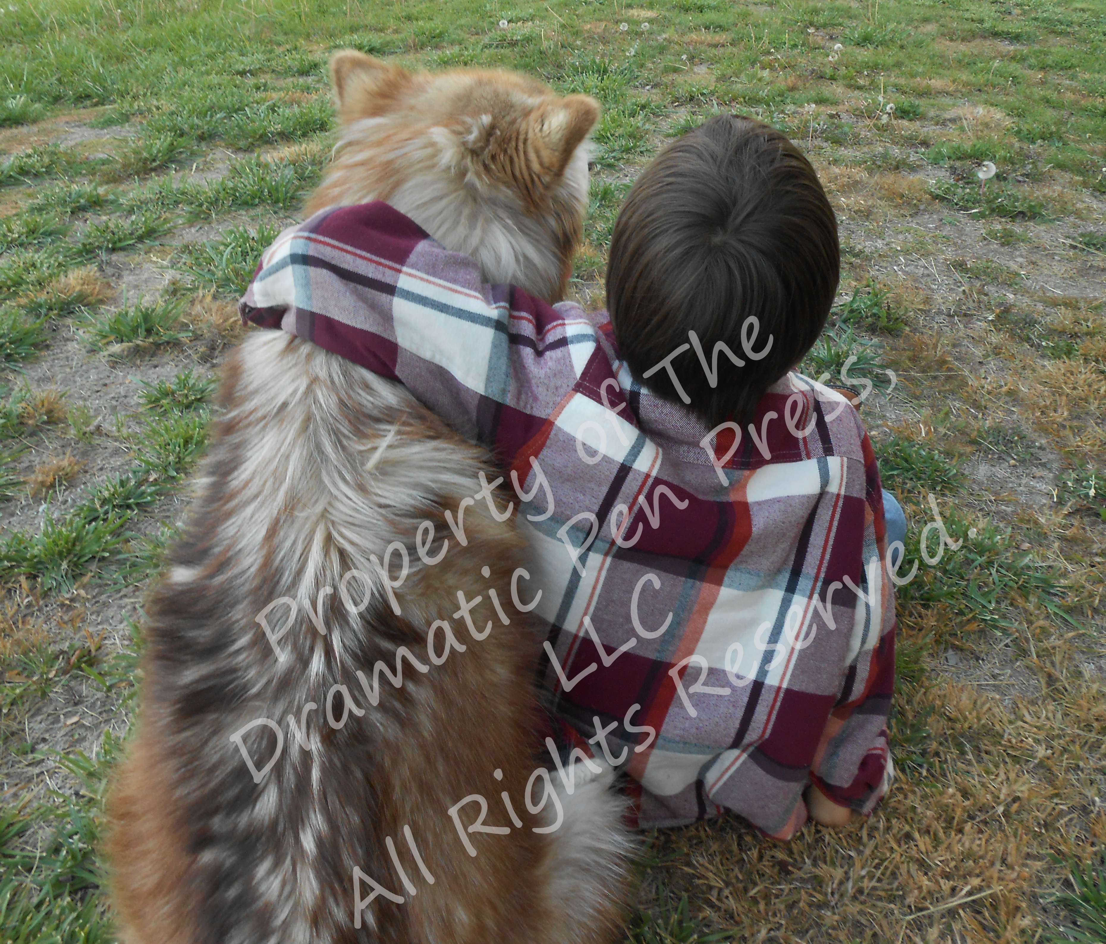Boy Sitting with Dog Looking Away