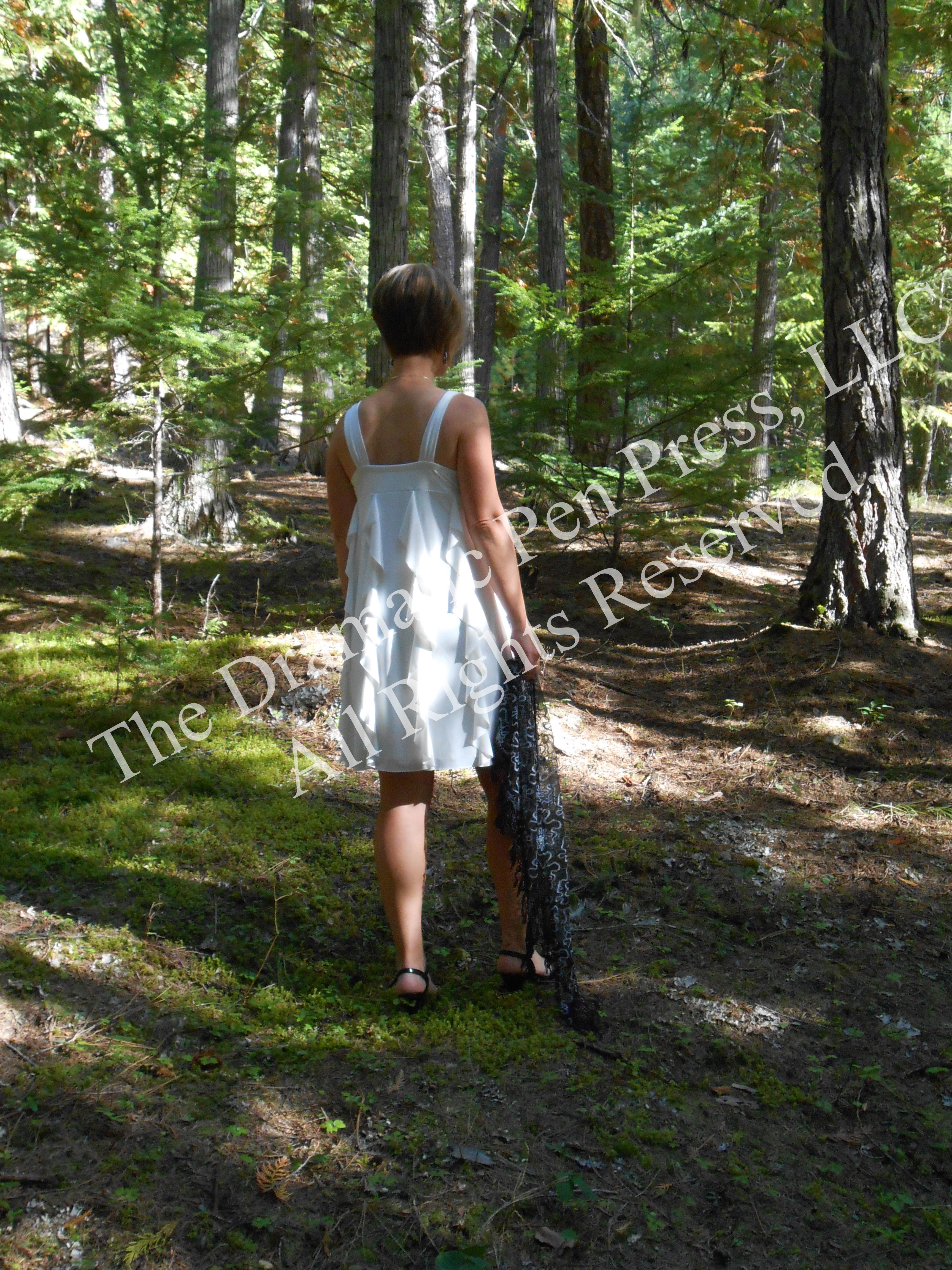 Woman in White Dress Walking Woods