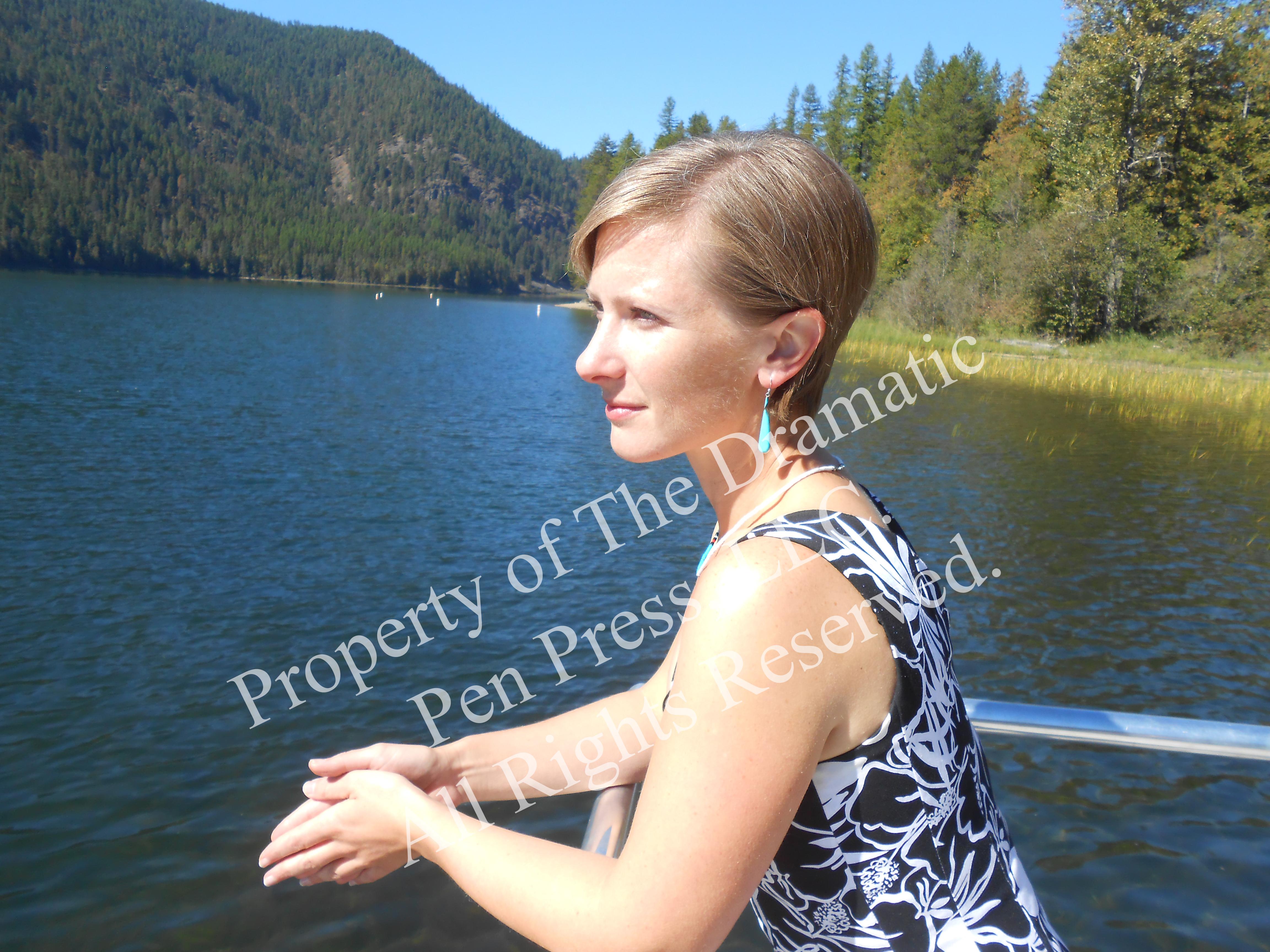 Woman Leaning on Rail Lakeside