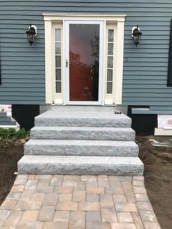 Design & Install: Granite Entry Steps, Landing, Granite Walkway Steps and Boulders, Granite Light Post, Paver Walkway