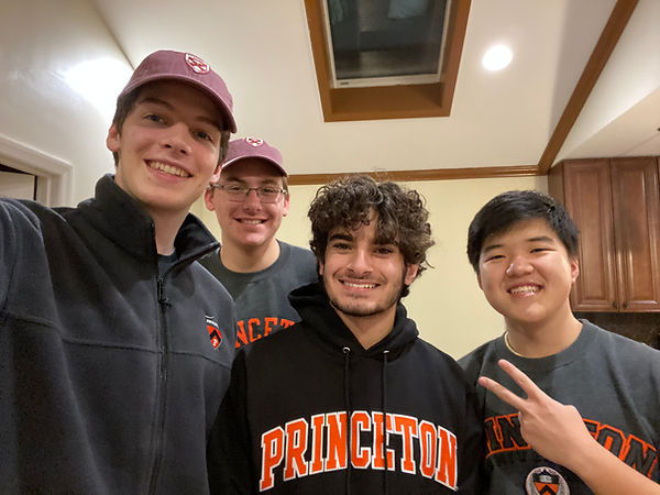 Picture of Benjamin Howe and his three roommates turned friends.