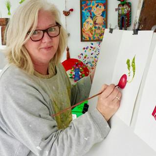 Lisa McGlinchey painting the veggies Jul