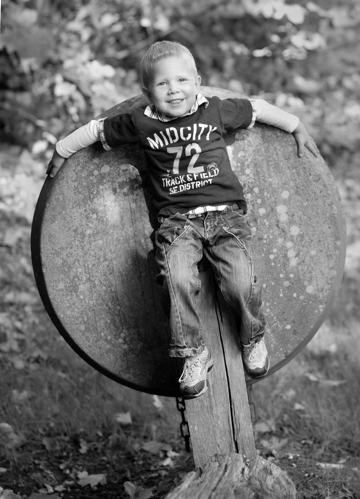 boy on millstone 2 sh