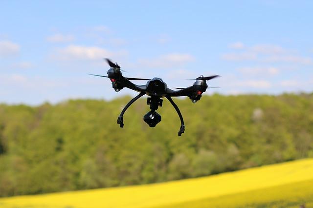 A drone crossing a field