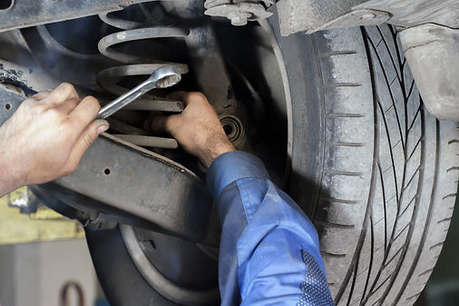 mechanic-fixing-suspension-lg.jpg
