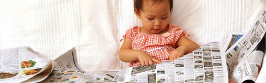 teaching child how to read the newspaper