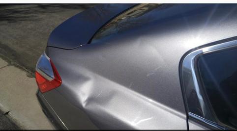 Rear Panel Dent Damage