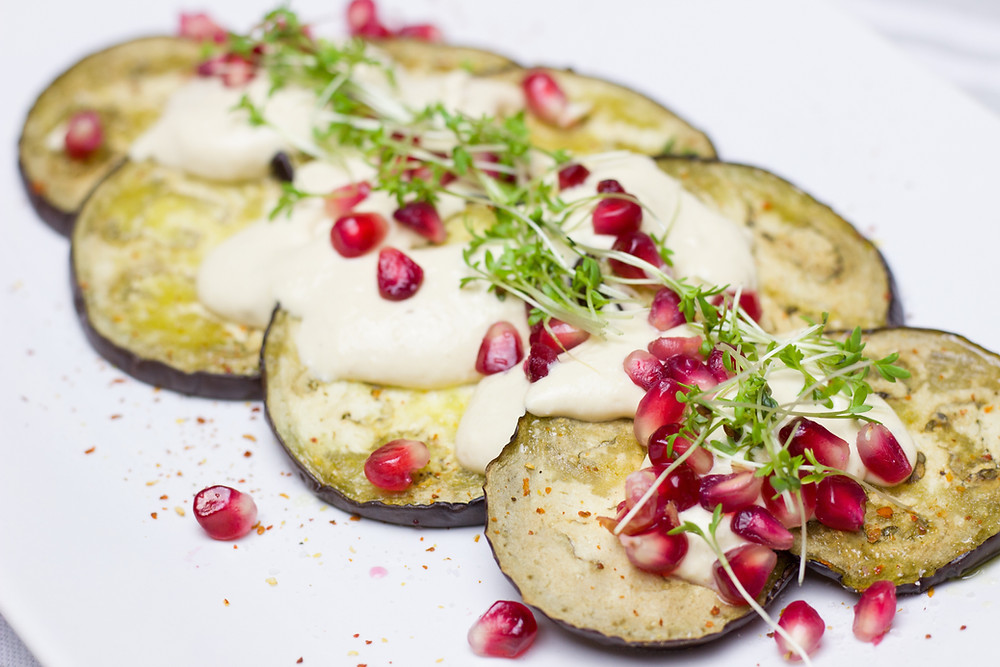 Preparing Roasted Eggplant with pomegranate healthy keto friendly recipe