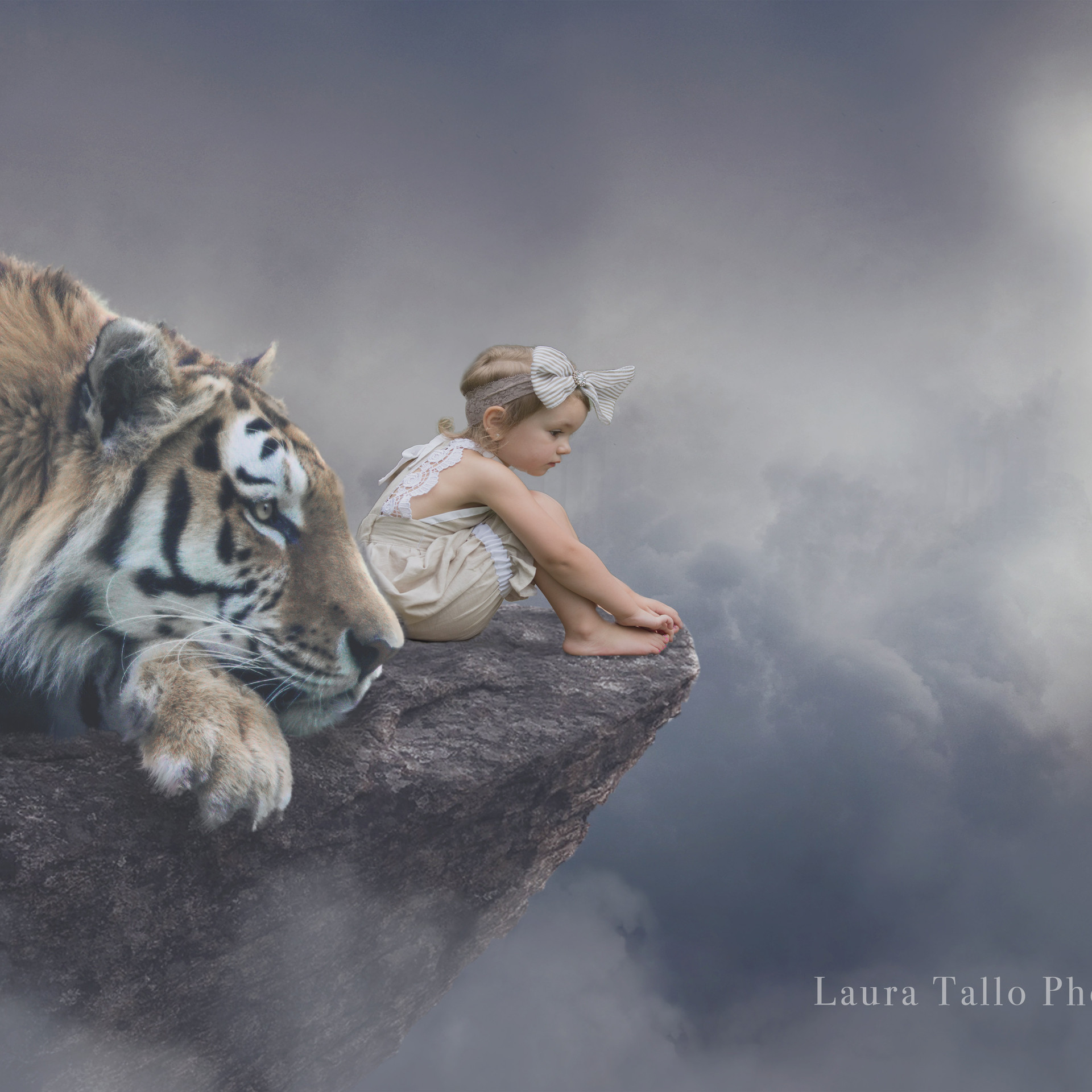 Little girl with a tiger on a cliff