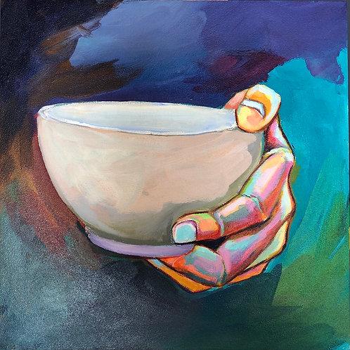 Hand holding bowl