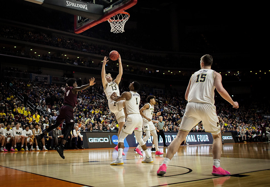 University of Michigan freshman forward Ignas Brazdeikis catches a rebound in the first half. Michigan's height allowed them to dominate rebounding, making it challenging for the Griz to capitalize on any missed shots.