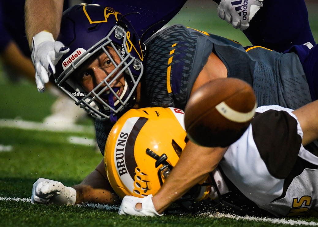 Sentinel High School defensive back Soren Syvrud watches the ball bounce away after making a tackle during the first half of the Spartan's 35-0 victory over Helena Capital High School on Sept. 18, 2020 in Missoula, Montana.