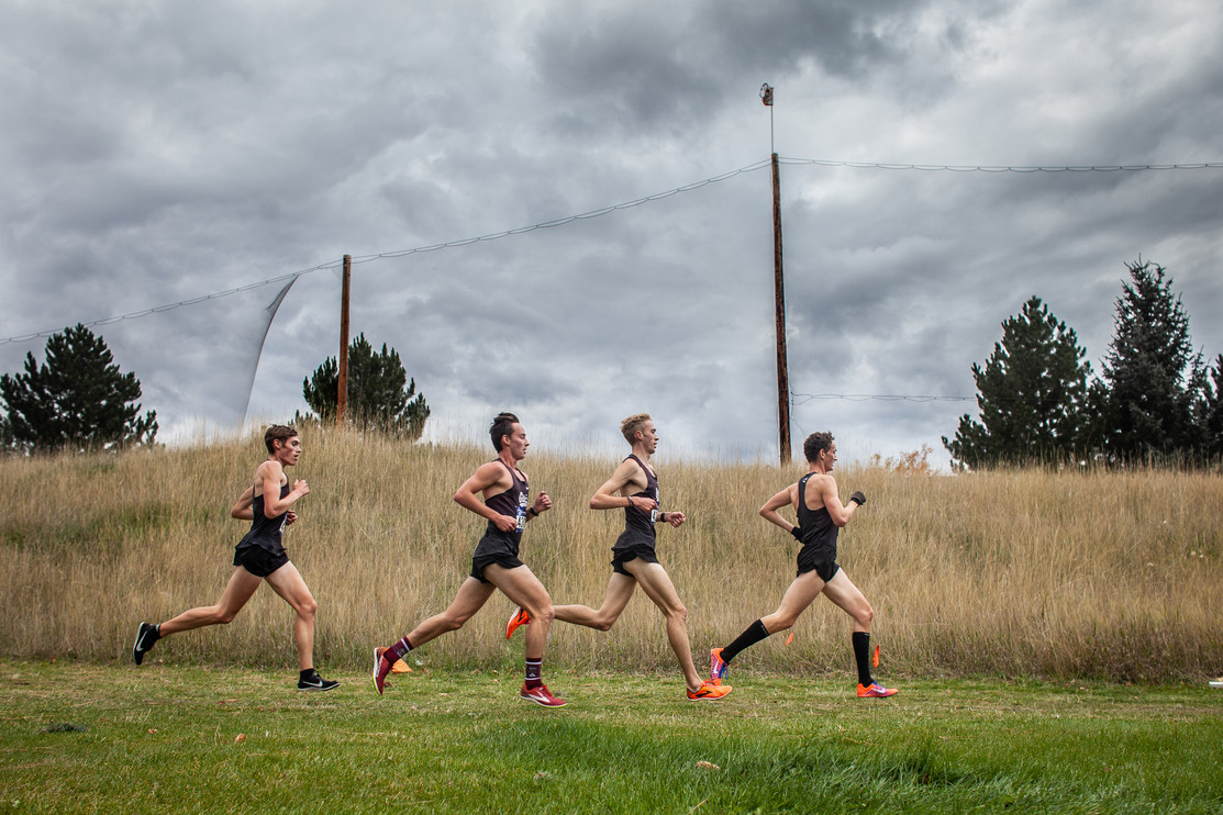 The University of Montana men's pack, Kyle Peterson, left, Ben Vanderbosch, Will Dauenhauer and Hunter May heads into its second lap around the course during the Montana Invitational on Oct. 5, 2019 in Missoula, Montana. The four Griz ran together for the entire race, eventually finishing 2-5 scoring and helping their team win the home invitational.