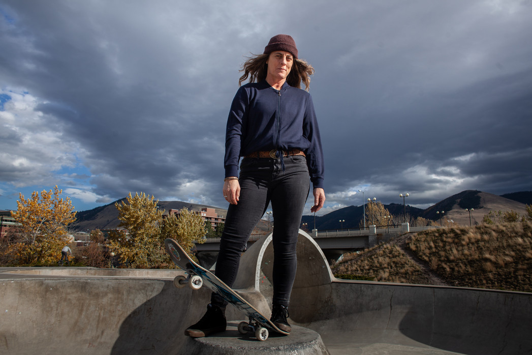 Former professional skateboarder, Kim Petersen, stands in the Mobash Skate Park in Missoula during a late-fall skate session in 2019. Petersen, a first-grade teacher, encourages young women to pursue skating through teaching in her classroom and non-profit work around the state.