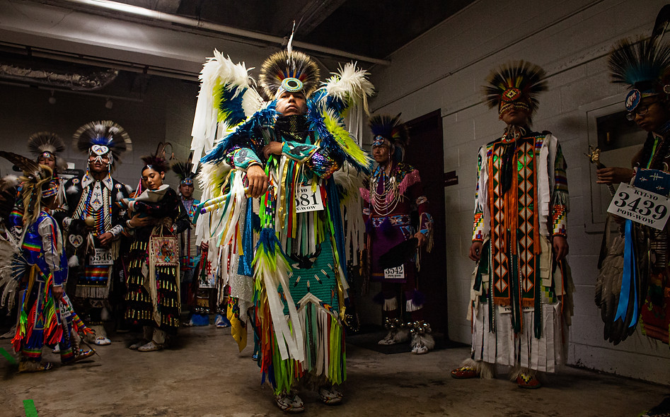 Baker waits for the Kyiyo Powwow Grand Entry to begin in a tunnel below the arena. He and his siblings rushed to make it to Grand Entry on time, after needing to make a last-minute trip to Home Depot for regalia repair supplies. However, Baker has never missed a grand entry, and Kyiyo was no exception, he made it with a minute to spare.