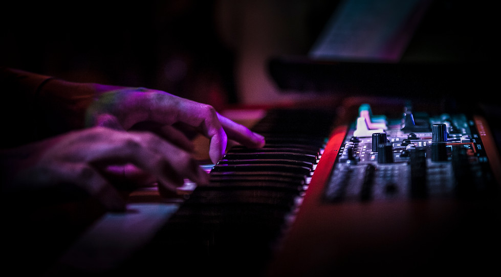 The hands of Connor Racicot dance across his keyboard near the back of the stage. Racicot played keyboard for the Fertile Crescent and their opener, She Don't LIke Dancing Alone.