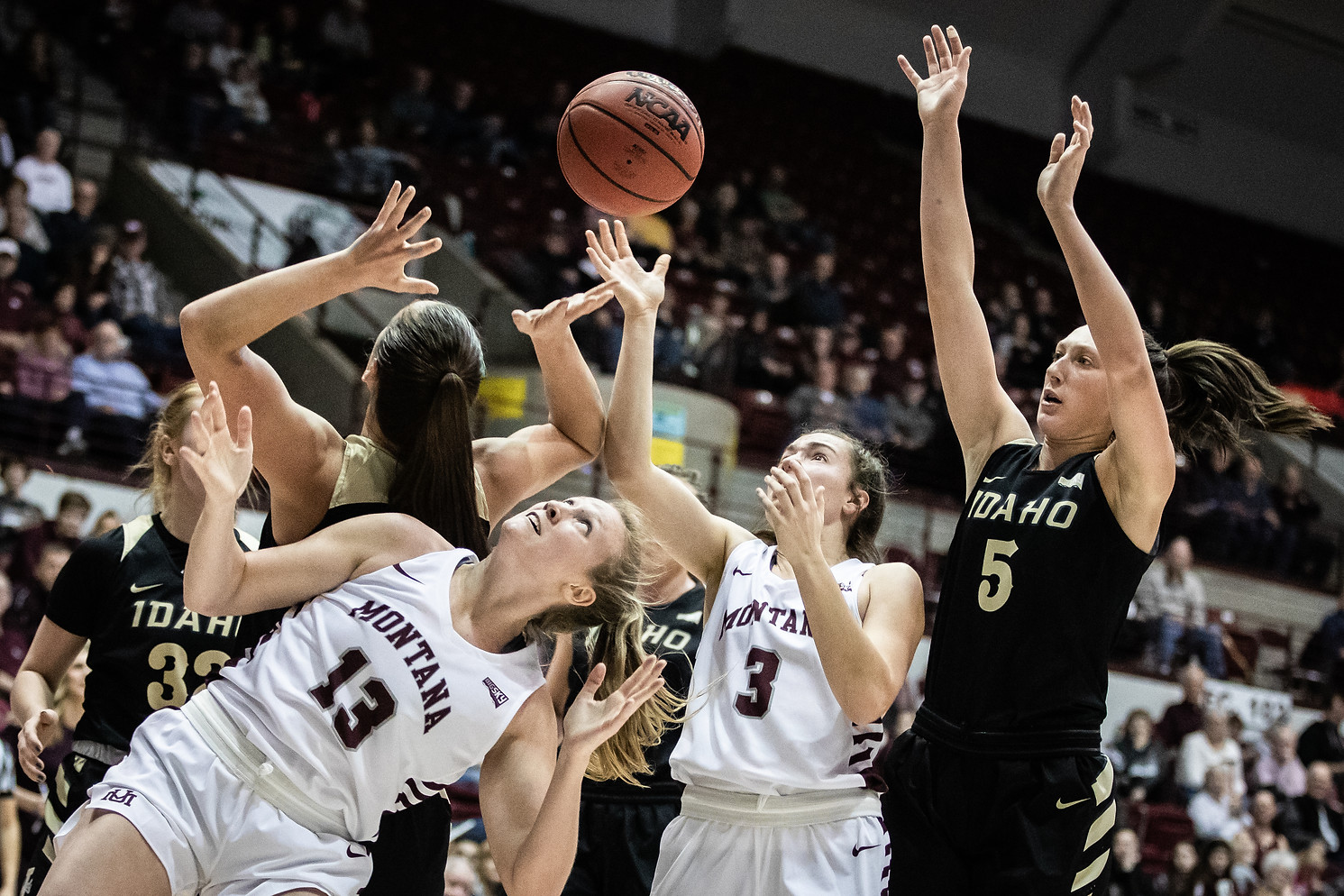 Montana sophomore forward Kylie Frohlich (13) and guard Gabi Harrington (3) battle Idaho defense for a rebound in the third period of the Lady Griz 69-60 victory over the Vandals Feb. 8, 2020 in Dahlberg Arena.
