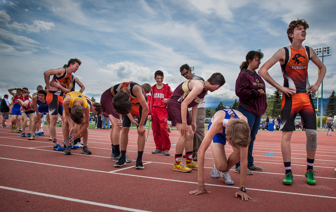 Competitors in the boys Montana Class B 1600-meter race catch their breath moments after finishing the event in Missoula, Montana on May 16, 2019. The winners of the event qualified for the state meet.