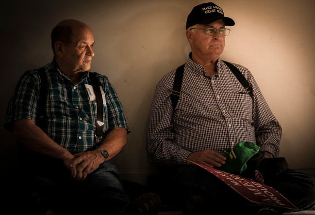 Randy Lamphere, left, sits with a friend, who prefers to go unnamed, in a sunbeam slanting into the hangar at about 4:30 p.m.