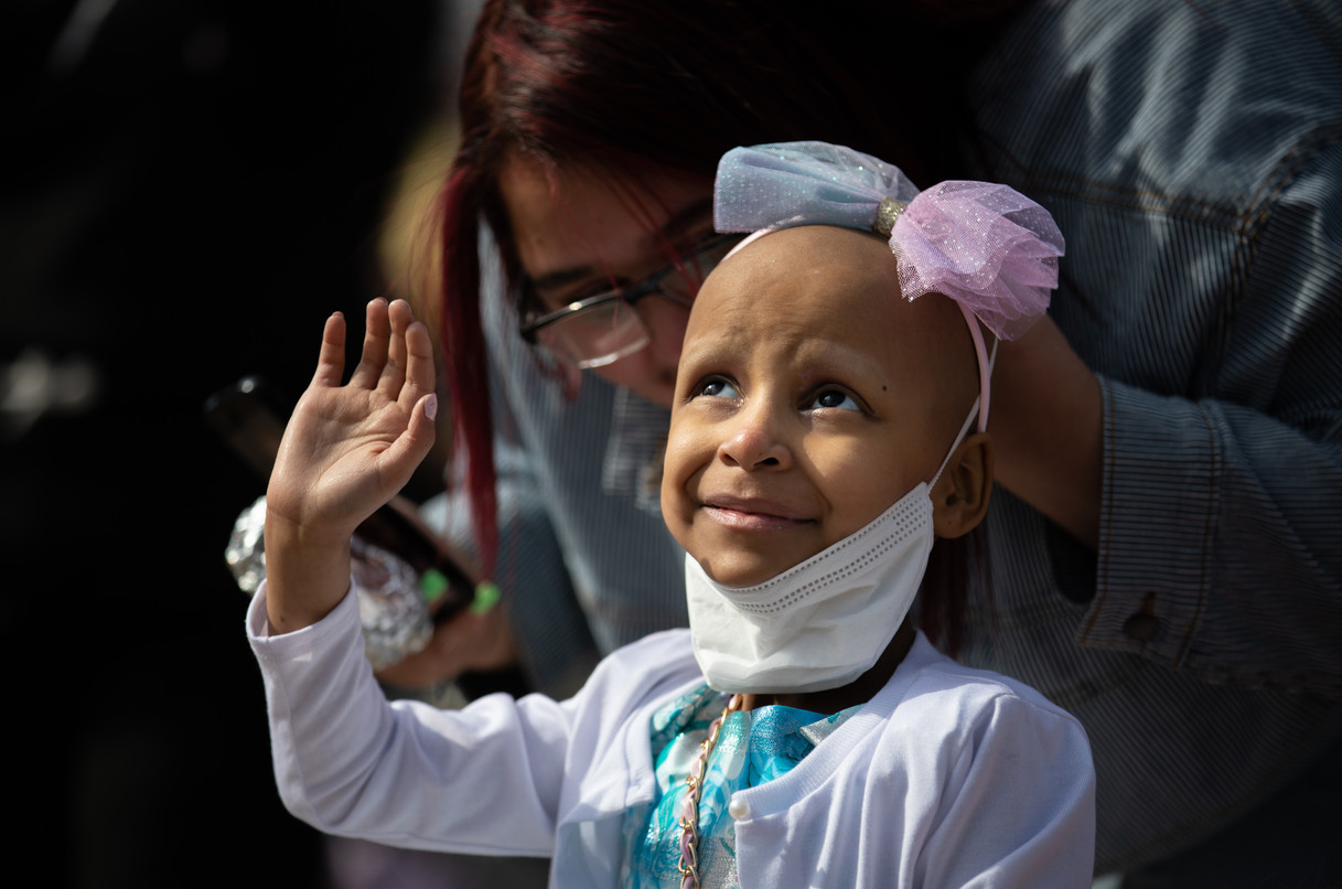 Paydenn Shelton glances up at the sky as she waves to her birthday parade proceeding past January-Wabash Park in Ferguson on March 6, 2021.