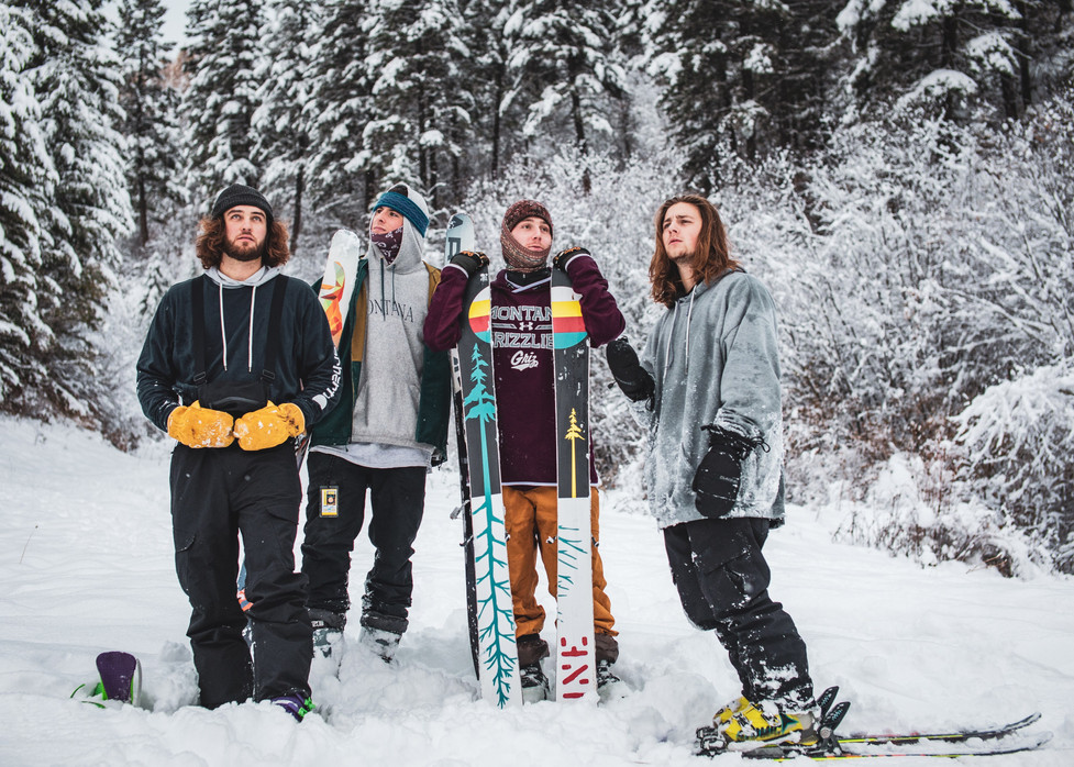 The presidency of the University of Montana Big Mountain / Freeride Club pretend to contemplate their final exams while standing for a photograph at Marshall Mountain on Nov. 11, 2020 during an early season ski session. From left to right, Treasurer Tyler Rubendall, President Henry DeLuca, Public Relations Officer Jack Rinck, and Vice President Ethan Schock. The pandemic brings new challenges to the ski season for both in-resort and backcountry skiers.
