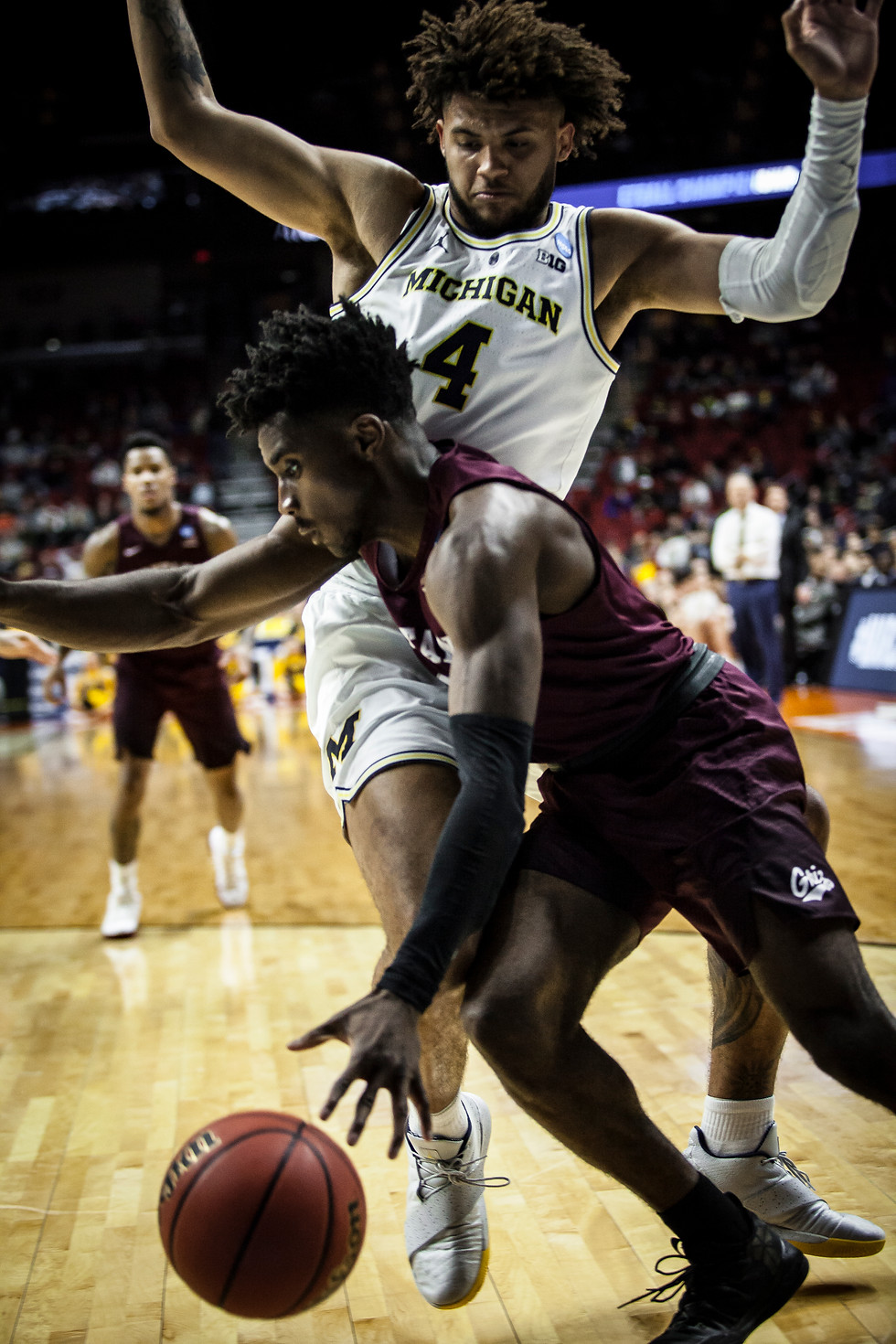 University of Montana senior guard Michael Oguine attempts to push past a University of Michigan sophomore forward Isaiah Livers during the second half of the game. This was Oguine's last game as a Griz- he finishes his career at the University of Montana ranked seventh in points scored (1,647).