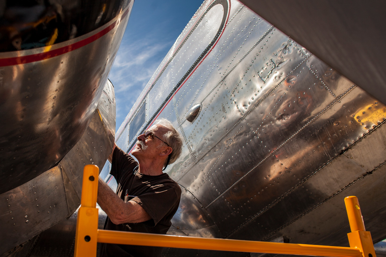 Jeff Whitesell, chief pilot of Miss Montana, adjusts her propeller governors after a test flight on May 12, 2019. The World War II era aircraft spent months being repaired at the Museum of Mountain Flying in Missoula before making the journey to Normandy to help celebrate the 75th anniversary of D-day.