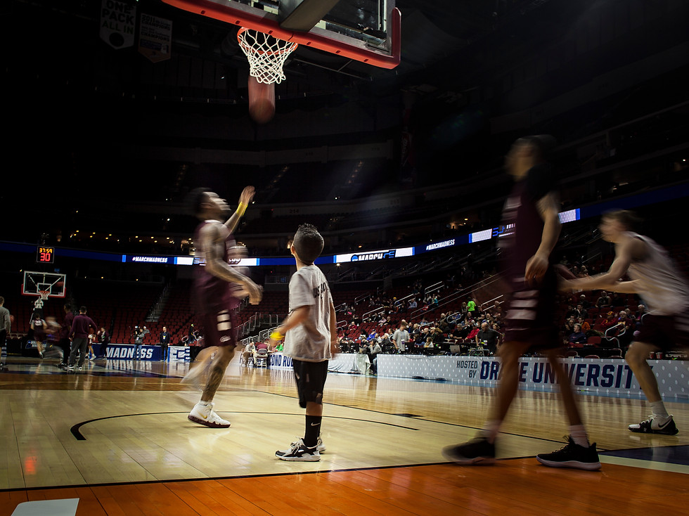 Joaquin Wortham, son of University of Montana assistant coach Rachi Wortham, helps the Griz during an open practice on March 20, 2019 before their March Madness first round game in Des Moines. Wortham made the trip to Des Moines with the Griz, flying on their charter plane with the rest of the team, families and boosters.