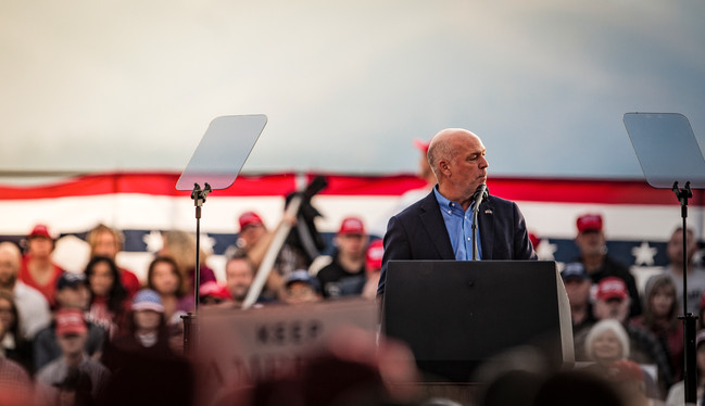 "Republican representative Greg Gianforte speaks to the rally. ""Can you imagine if Hillary Clinton was president,"" said Gianforte, generating booing from the crowd. ""It is an honor and privilege to serve as your lone representative,"" he continued, before introducing the president."