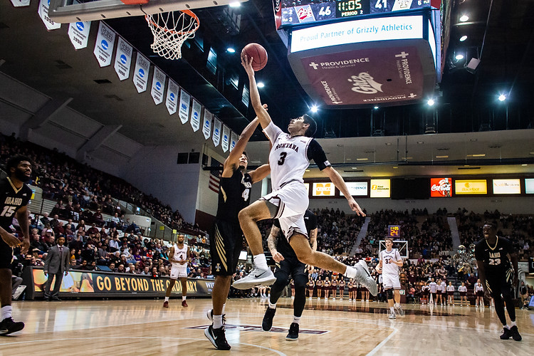 Montana freshman guard Josh Vazquez dodges toward the hoop for a layup as University of Idaho guard Keyshaad Dixon attempts to defend during the second half of the Griz victory over the Vandals Jan 18, 2020 night in Dahlberg Arena.