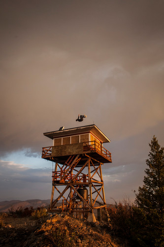 Micah Pengilly, an Unparralleled Movement Parkour athlete, flips atop an abandoned fire watch tower near Flathead Lake. Parkour is a fast growing sport in Western Montana, where the local scenery fits with the trend of finding interesting locations to perform movements.