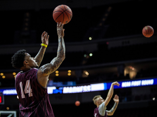 University of Montana guards Ahmaad Rorie, front, and Timmy Falls practice three-point shots during the open practice.