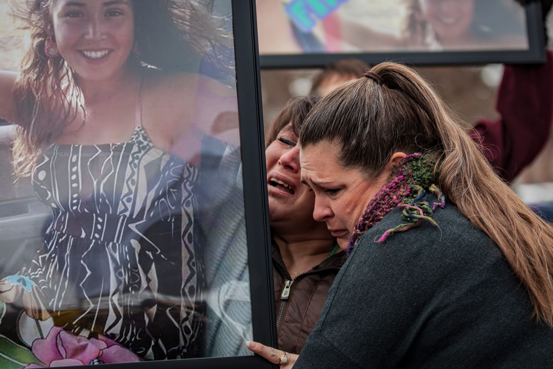 Marla Loring, center, holds an image of her niece, Ashley Loring Heavyrunner, during the Missing and Murdered Indigenous Women Vigil at the University of Montana on Jan. 19, 2019. Heavyrunner has been missing since June 5, 2017. The 20 -year-old college student disappeared from the Blackfeet  Reservation just before she was set to move into a new apartment in Missoula.