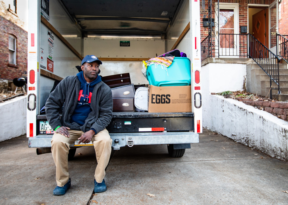 Ryan Gipson rests on the back of a rented U-Haul truck during his move to a new apartment in University City on Jan. 20, 2021. Gipson's former landlord turned off the electricity to Gipson's old apartment. He recently found a new one nearby, with cheaper rent.